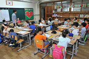 South Korea has one of the world's top-performing school systems yet spends far below the U.S. on education.