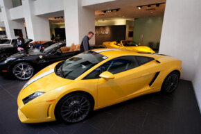 A Lamborghini sits on the showroom floor with other luxury and sports cars offered for sale at Bentley Gold Coast on April 9, 2010 in Chicago, Ill. See more pictures of exotic cars.