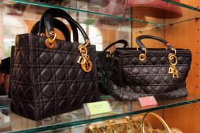 The Counterfeit Museum in Paris actually displays originals and fakes, like these Dior bags; the real one is to the left.
