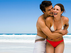 couple laughing on beach