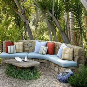Bring a touch of the indoors out to create a cozy outdoor living space.