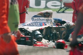 People gather around Ayrton Senna's crashed car.