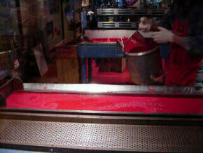 Liquid paraffin in a mold during the crayon manufacturing process. Click picture for a 5-second movie clip.