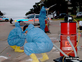 Cleaning up after a murder outside an apartment complex.