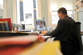 An INTERPOL officer is at work on May 5, 2008 at the Lyon-based agency, eastern France, on images of a man who is thought to be involved in child abuse.