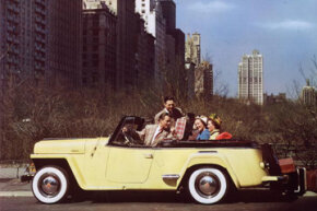 Two couples riding in a yellow Jeepster through Central Park, New York. See more pictures of classic cars.