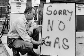 On June 1, 1973, Leon Mill spray paints a sign outside his Phillips 66 station in Perkasie, Pa., to let his customers know he is out of gas.