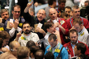 Traders work on the crude oil options pit at the New York Mercantile Exchange on March 11, 2009.
