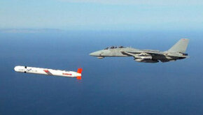 Tomahawk cruise missile escorted by F-14