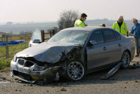 This BMW has obviously suffered a severe impact and appears extensively damaged. However, none of the damage was to the passenger compartment -- the front crumple zone did its job.