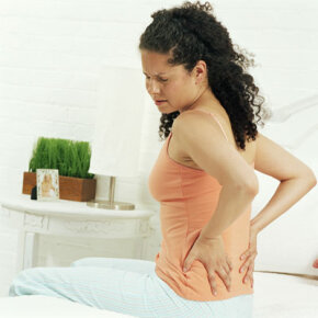 Waking up with back pain? It could be work-related.