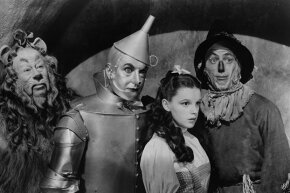 """Bert Lahr as the Cowardly Lion, Jack Haley as the Tin Man, Judy Garland as Dorothy Gale and Ray Bolger as the Scarecrow in a scene from the 1939 classic film """"The Wizard of Oz."""""""