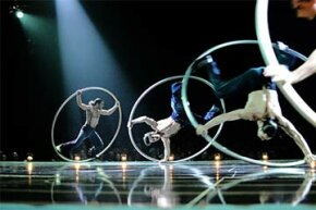 Artists perform solos and group figures on Cyr wheels during the Belgian premiere of the Cirque du Soleil show 'Corteo' in 2012.