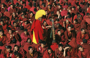 Tibet Image Gallery Buddhist Monks in Lhasa, Tibet wear maroon robes and distinctive yellow hats. See more pictures of Tibet.
