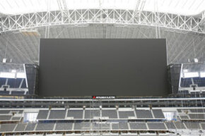 Despite the objections of various coaches and players, the scoreboard in the Dallas Cowboys stadium isn't likely to go dark soon.