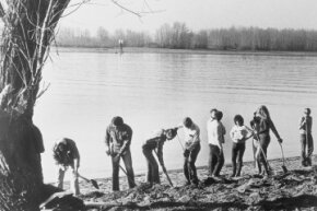 FBI agents dig in the sand on the north shore of the Columbia River where a portion of the D.B. Cooper hijack money was found.