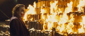 "Heath Ledger as ""The Joker"" watches as piles of money burns."