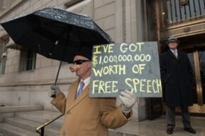 A demonstrator holds a sign outside the U.S. Chamber of Commerce during a rally against the Supreme Court's decision in favor of Citizens United, which allows private citizens and corporations to make unlimited donations for political campaigns.
