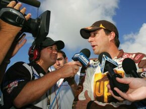 David Reutimann speaks to media after qualifying in the NASCAR Sprint Cup Series Ford 400 at Homestead-Miami Speedway, Homestead, FL, November 2008.