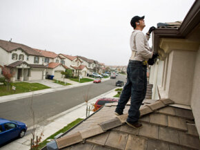 NorthWoods inspector Manny Nevarez inspects the roof of a home in Sacramento, Calif., before it goes on the market.