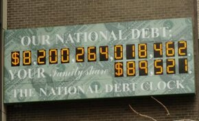 The National Debt Clock at 1133 Avenue of the Americas and 44th Street, March 26, 2006, in Manhattan.