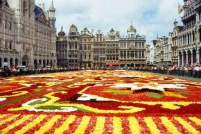 The flower carpet at the Grande-Place, Belgium. Despite its small size, Belgium's reputation as an international banking center means lots of financial transactions reside here.