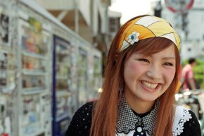 A Japanese girl smiles in a Tokyo city street. Japan is America's second-largest foreign creditor.