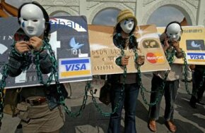 Local consumers who are in credit card debt, referred to as 'credit card slaves', take part in a demonstration calling for the government to pass a law to help people oweing money to banks, June 2, 2007, in Taipei.