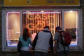 Tourists look inside the window of a pawnshop in Atlantic City, New Jersey, May 2007. See more debt pictures.