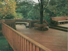 This deck features a tree surround to accommodate a growing trunk yet provides plenty of floor space.