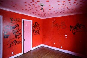 Graffiti is displayed on the bedroom wall at one of 12 homes being auctioned off (with starting bids of $1,000) in the East English Village neighborhood in Detroit, Michigan. The homes were in foreclosure.