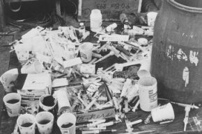 Guyanese officials found piles of paper cups with cyanide-laced fruit punch and syringes at Jonestown.