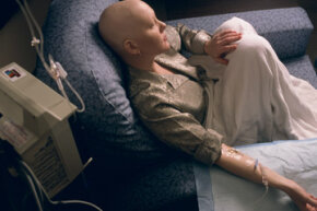A young woman receives chemotherapy. See pictures of alternative medicines.