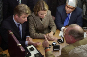 Belgian Princess Mathilde (C) and Prince Philippe (L) speak with a man at Antwerp's Diamond Market, considered to be the largest trading point for rough and cut diamonds in the world.