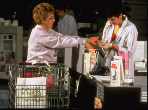 C'mon. Get your cholesterol checked. It's easy. This woman is having hers evaluated at a supermarket testing booth.