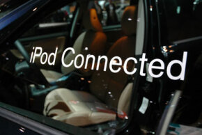 BMW created the first car with an iPod dock, and other manufacturers followed suit. Volvo displays its iPod connection at the 2005 New York City Auto Show.