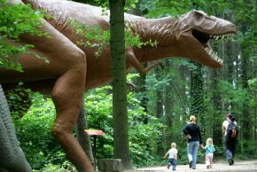 Right now, the closest people can get to realistic dinosaurs are movie screens, fossils and life-sized models, like this one at Dinosaur Park. See more dinosaur pictures.