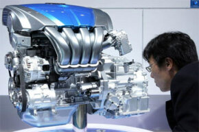 "A visitor examines the new Mazda Motor Corp.'s direct injection engine ""Mazda SKY-G"" during the Tokyo Motor Show in October 2009."