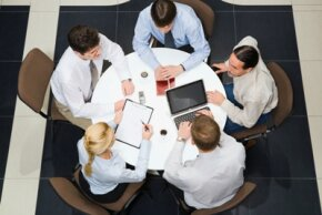 Executives collaborate to create a plan.