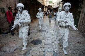 White blood cells patrol your city's streets for viral threats? Actually, those are Israeli street artists.