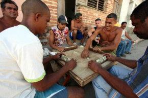 Men play dominoes on the sidewalk in Trinidad, Cuba in 2007.
