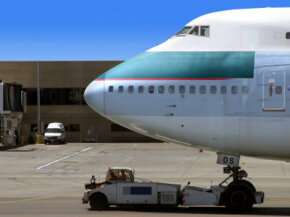 This is a good example of drawbar pull. How does such a small tractor pull a huge jet airliner?