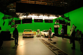 "The cast and crew set up for a shot in front of the green screen on the set of ""Drive"""