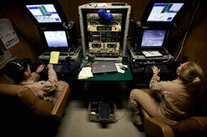 U.S. military pilots in Las Vegas steer high-tech Predator drones -- complete with infrared camera, still camera and two missiles -- above Afghanistan.