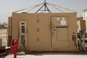 The Predator drone ground control station at Bagram Airbase in Afghanistan is high-tech despite its shacklike appearance.