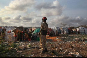 A Somali soldier looks onto a camp for people displaced by famine and drought on Aug. 19, 2011, in Mogadishu, Somalia.