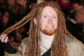 Newton Faulkner and his dreadlocks attend the Brit Awards.
