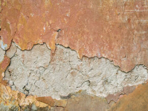 A plaster wall (shown here) is much thicker than drywall. But that's not the only difference.