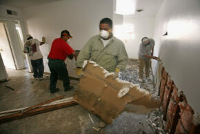 Workers remove drywall from a New Orleans apartment damaged by Hurricane Katrina. Drywall has become one of the most versatile building materials available. See more pictures of home construction.