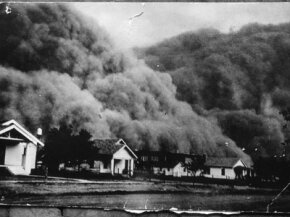 A giant dust storm blacks out the sky of Goodwell, Okla., during the Dust Bowl.